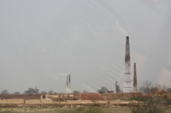 On the way to Agra, you can see the smoke stacks of the brick makers.