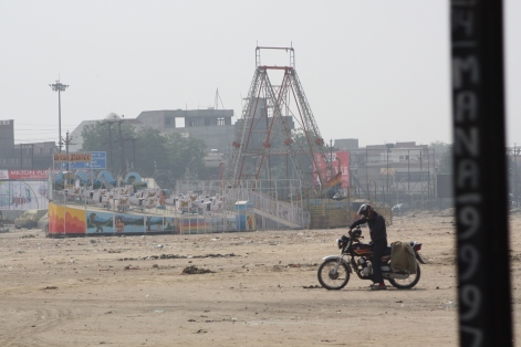 Beat up carnival rides, and a motorcycle. Definitely a surreal image.